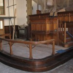 The communion rail on the extended stage