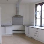 The kitchen with linoleum floor
