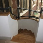 Top of the spiral staircase with handrails