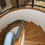View down on to the spiral staircase with handrails