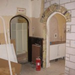 Doorways leading from the hall to the kitchen and store room