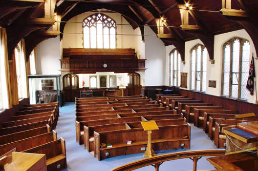 The worship area with pews and balcony